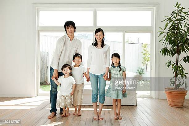 Family with three children at home, portrait