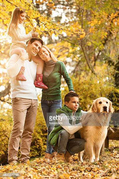 Family with two children and a dog in the park