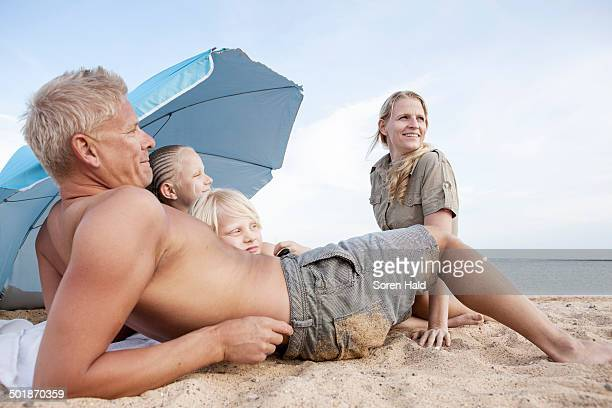 Family with two children relaxing on beach