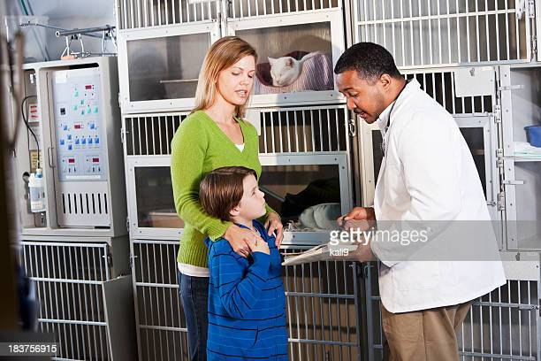 Family with vet in animal clinic