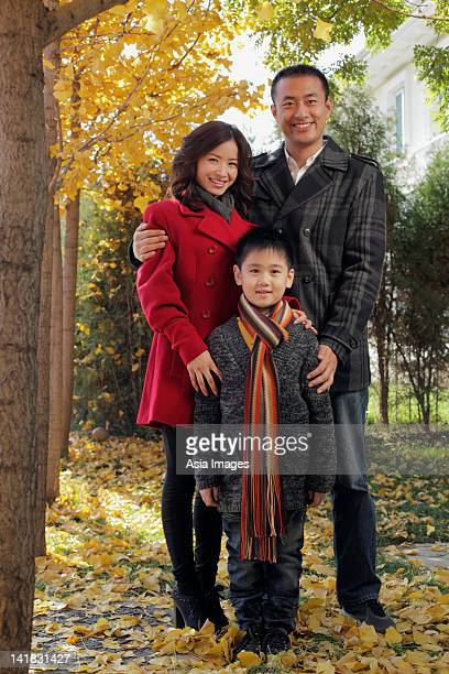 Family with young boy standing outdoors