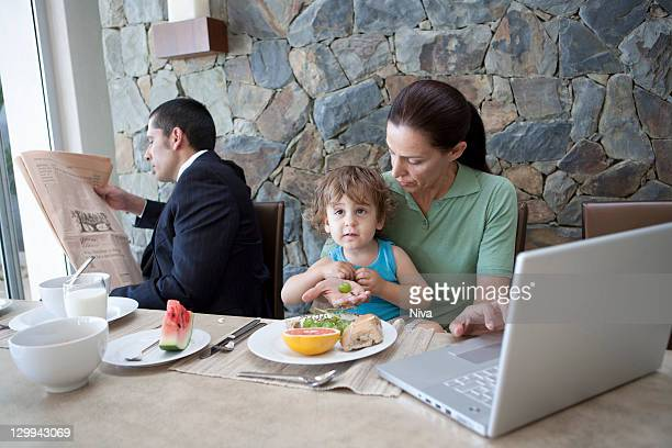 Family working at breakfast table
