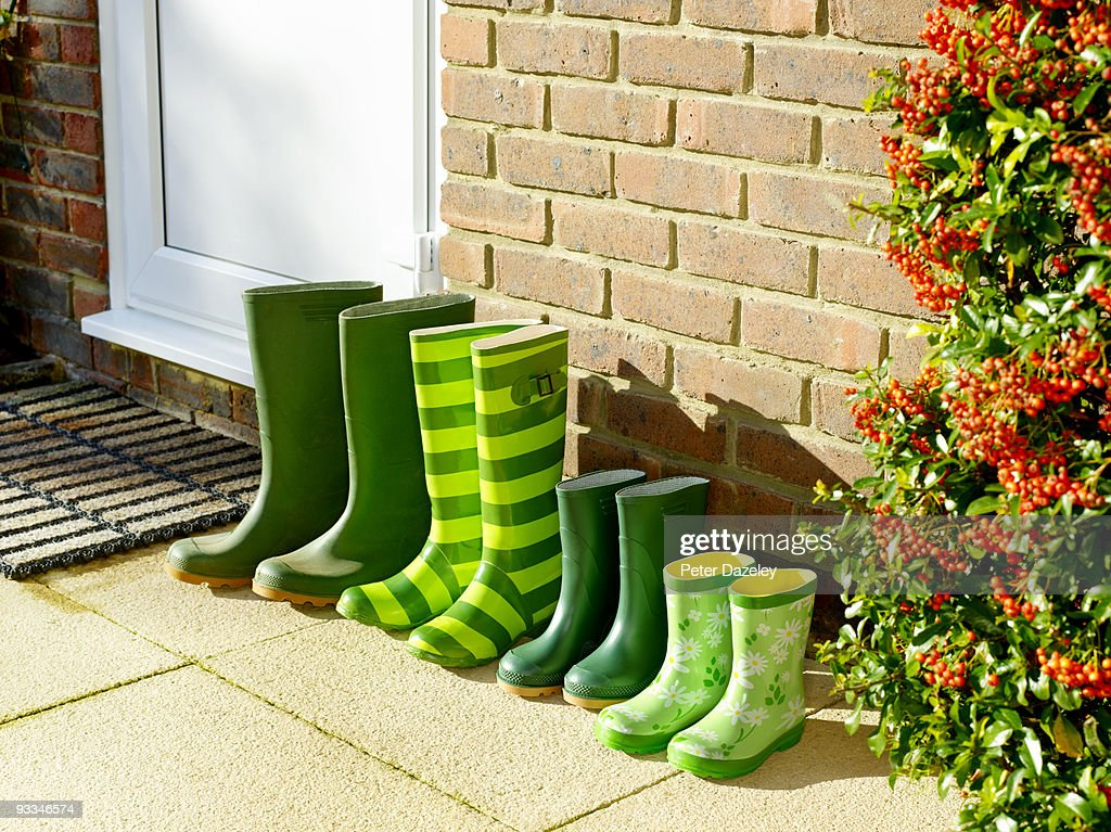 Family's green Wellington boots by back door.