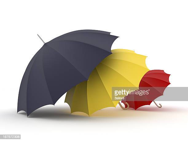 A family's umbrellas of varying sizes