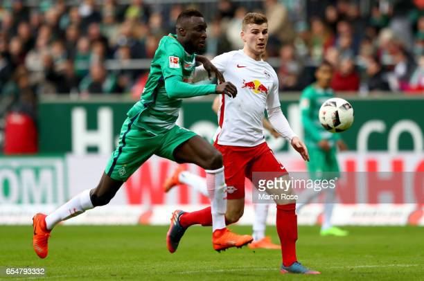 Famine Sane of Bremen is challenged by Timo Werner of Leipzig during the Bundesliga match between Werder Bremen and RB Leipzig at Weserstadion on...