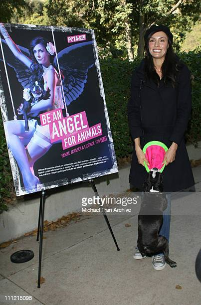 Famke Janssen and her dog Licorice during XMen Star Famke Janssen to Unveil Sexy New PETA Ad Seeking Holiday Help for Pups at Runyon Canyon Park in...