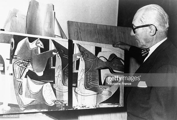 Famous architect Le Corbusier in front of a painting for the Pavillon Switzerland of the Cite Universitaire de Paris 1948 in France