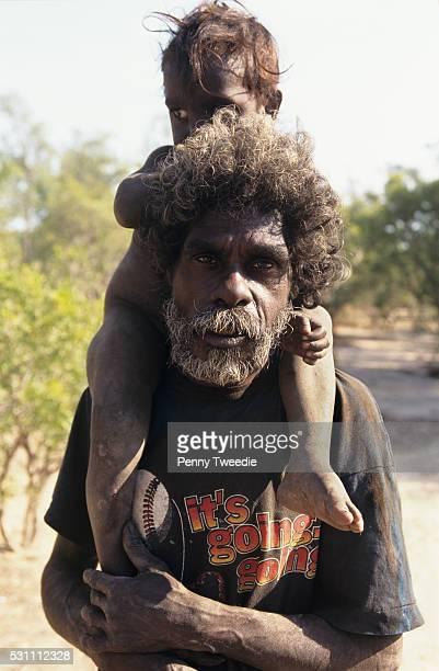 Famous artist John Murwurndjul with his son at Mumeka in his clan country western Arnham Land His clan is Kurulk his language Kunwinjku He paints...