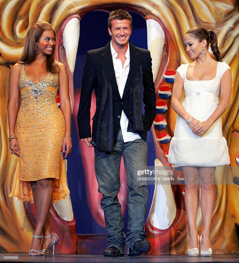 ¿Cuánto mide Jennifer López? - Altura - Real height Famous-british-football-player-david-beckham-us-actress-jennifer-and-picture-id52232359