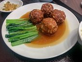 Lion's Head (simplified Chinese: 狮子头; traditional Chinese: 獅子頭; pinyin: Shīzitóu) or stewed meatball is a dish from the Huaiyang cuisine of eastern China, consisting of large pork meatballs stewed wit
