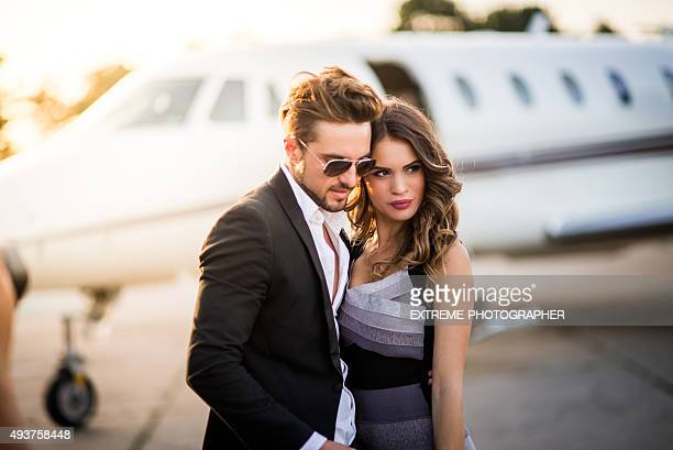 Famous couple posing at the airport track