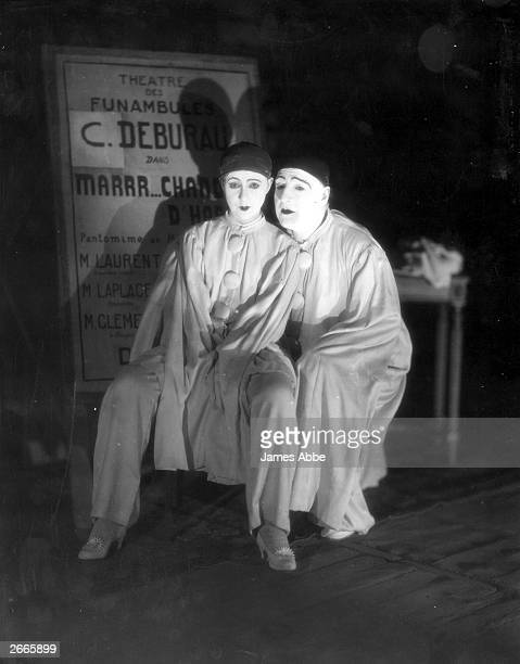 Famous French actor and playwright Sacha Guitry and his second wife Yvonne Printemps pose in their costumes for the stage play 'Debureau' at the...