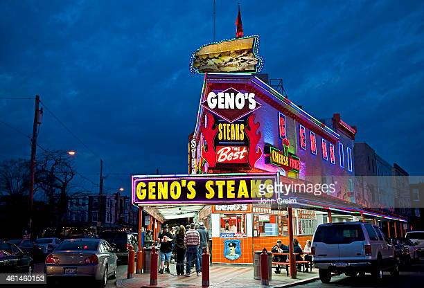 Famous Geno's Steaks at night