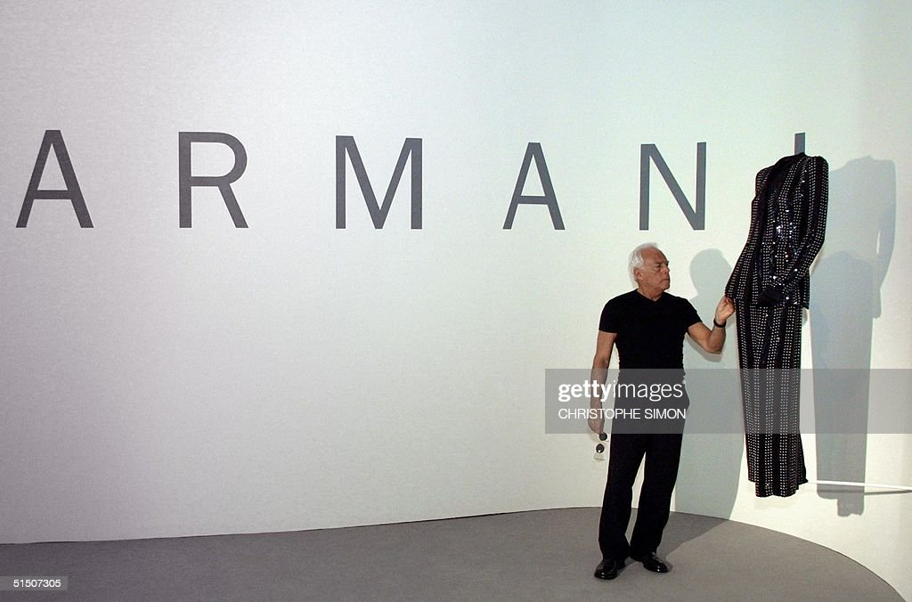 Famous Italian fashion designer Giorgio Armani poses near one of his creation in Bilbao's Guggenheim museum, 22 march 2001, where a dress exhibition is presented.