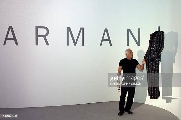 Famous Italian fashion designer Giorgio Armani poses near one of his creation in Bilbao's Guggenheim museum 22 march 2001 where a dress exhibition is...