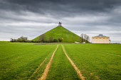 Panorama view of famous Lion's Mound (Butte du Lion) memorial site, a conical artificial hill located in the municipality of Braine-l'Alleud comemmorating the battle of Waterloo, on a moody day with d