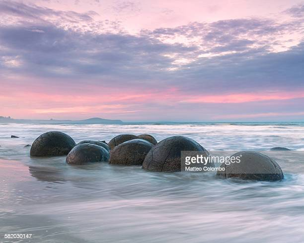 Famous Moeraki boulders at sunset, New Zealand