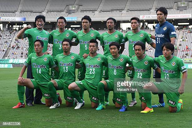 Famous pro wrestler Kenta Kobashi poses for photograph with players of Tokyo Verdy prior to the JLeague second division match between Tokyo Verdy and...
