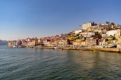 View of famous Ribeira neighborhood along Douro river in historic Porto, Portugal.