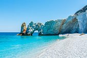 Famous hole in the rock formation at Lalaria beach, Skiathios island, Greece.