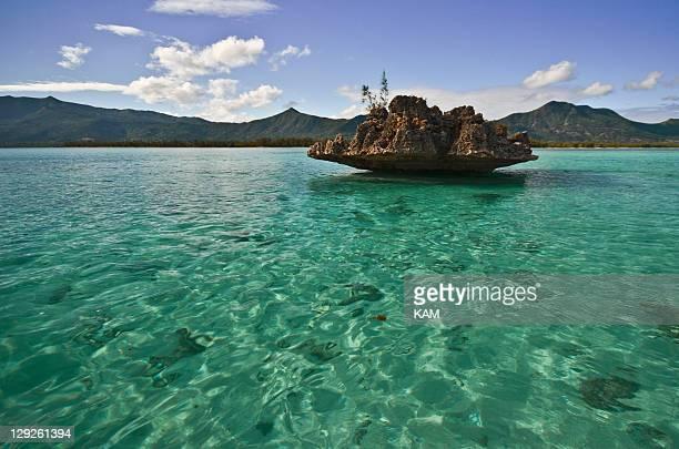 Famous rock on green lagoon in Mauritius