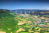 Best locations of world, fabulous viaduct of Millau in the far distance with agriculture fields, Aveyron region, France, Europe