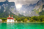 Beautiful fabulous alpine glacier lake Konigsee with stunning St Bartholoma church,Berchtesgaden,Bavaria,Germany,Europe