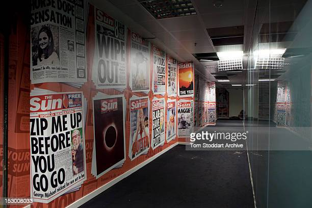 Famous Sun front pages on the walls of the deserted corridors near the Sun newsroom inside the former News International base in Wapping East London...