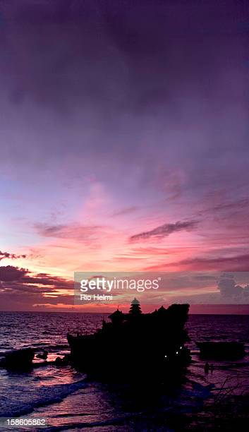 Famous tourist icon of Bali the Tanah Lot temple at sunset is a must for every first time traveller to Bali