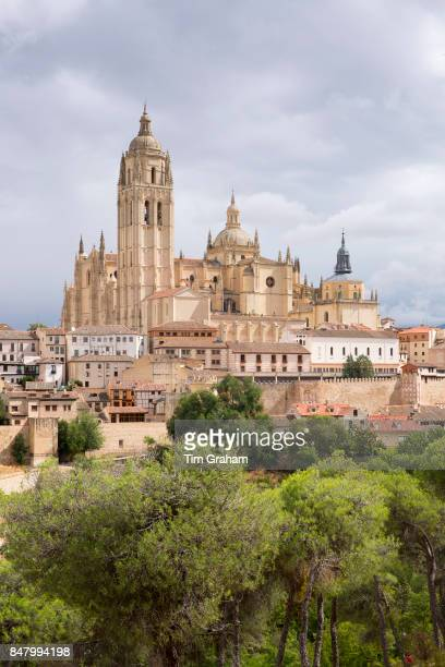 Famous view of Alcazar Castle palace and fortress which inspired Disney castle and Cathedral Segovia Spain