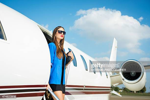 Famous woman exiting private jet airplane