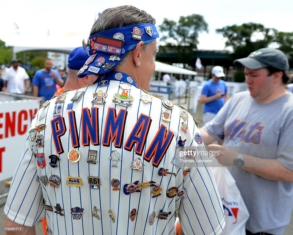 A fan adorned with pins outside Citi Field prior to the 2013 SiriusXM AllStar Futures Game at Citi Field Sunday July 14 in the Flushing neighborhood...