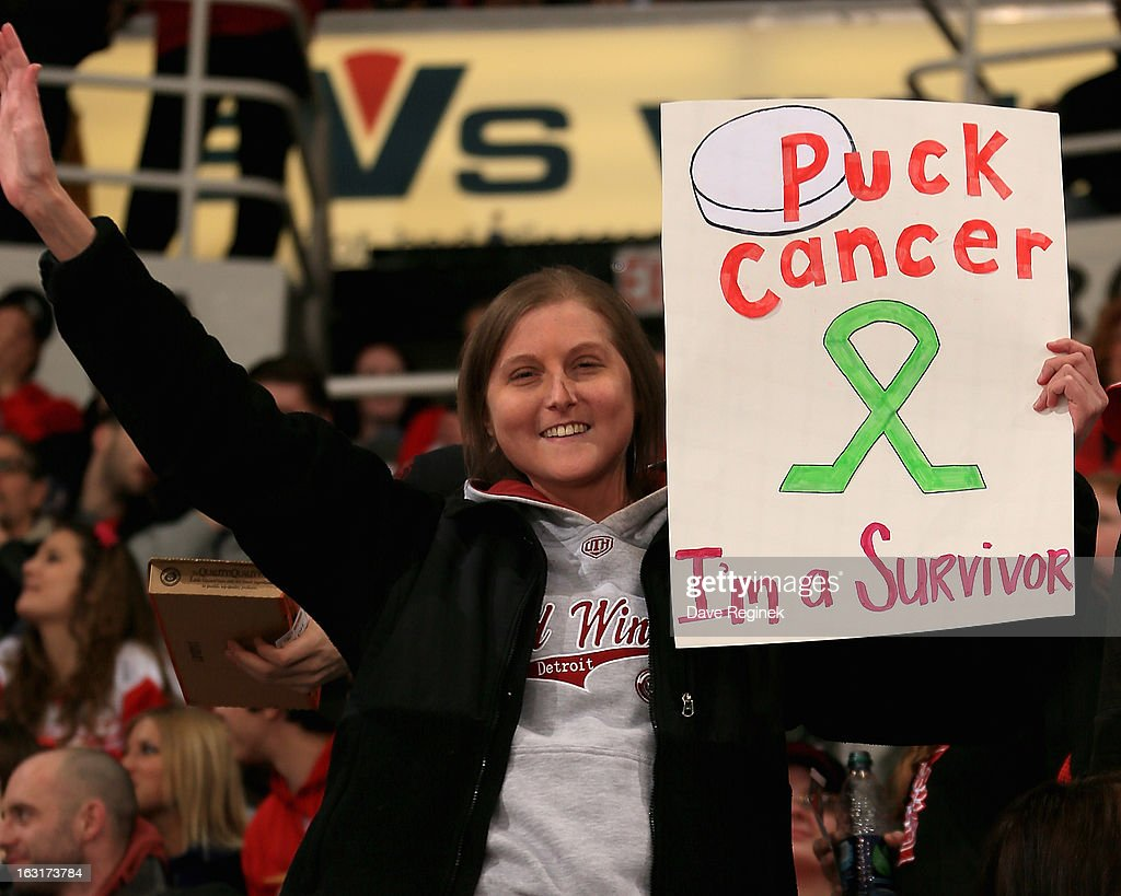 A fan and cancer survivor holds up her sign for Breast Cancer Awareness Night during a NHL game between the Colorado Avalanche and the Detroit Red Wings at Joe Louis Arena on March 5, 2013 in Detroit, Michigan.
