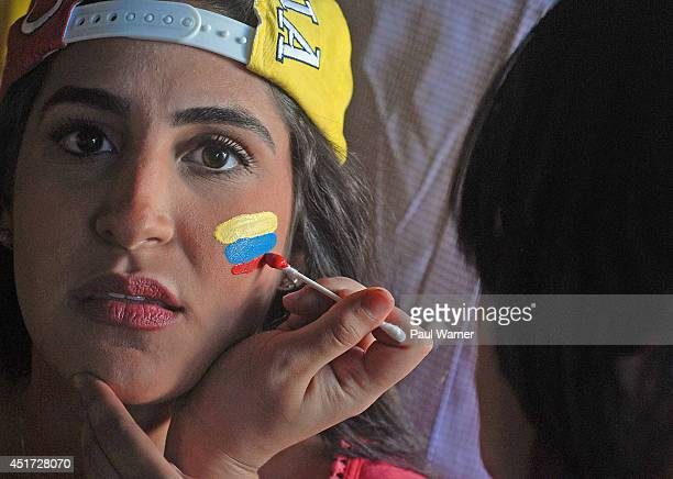A fan applying makeup at the Colombia vs Brazil World Cup quarterfinal match viewing party at the Red Fox English Pub on July 4 2014 in Royal Oak...