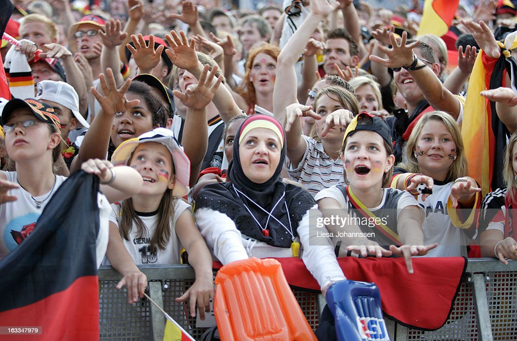 Fan area in Berlin during the FIFA World Cup 2006, International Soccer Tournament, Crowd cheering for the german team, Children with different migration background in the first row, Mexican wave, July 05, 2006, Berlin , Germany.