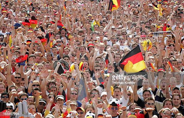 Fan area in Berlin during the FIFA World Cup 2006 International Soccer Tournament Crowd cheering for the German Team Bellowing together Mexican Wave...