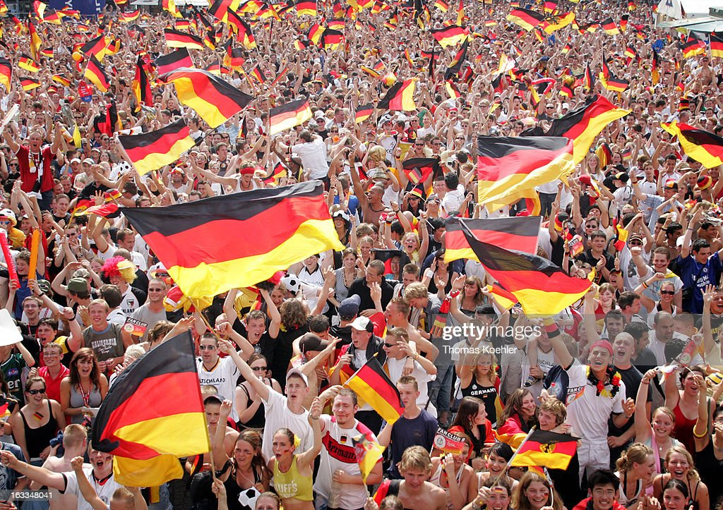 Fan area in Berlin during the FIFA World Cup 2006, International Soccer Tournament, Swinging German Flags, Fans cheering for the German Team, June 20, 2006, Berlin, Germany.