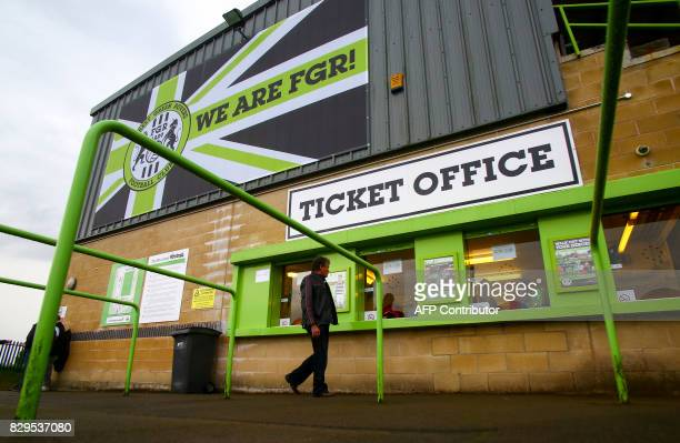 A fan arrives ahead of the EFL Cup football match between Forest Green Rovers and MK Dons at The New Lawn stadium in Nailsworth western England on...
