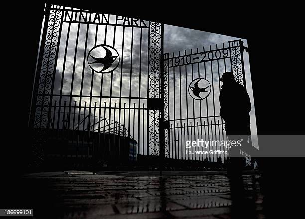 A fan arrives under stormy skies prior to the Barclays Premier League match between Cardiff City and Swansea at Cardiff City Stadium on November 3...