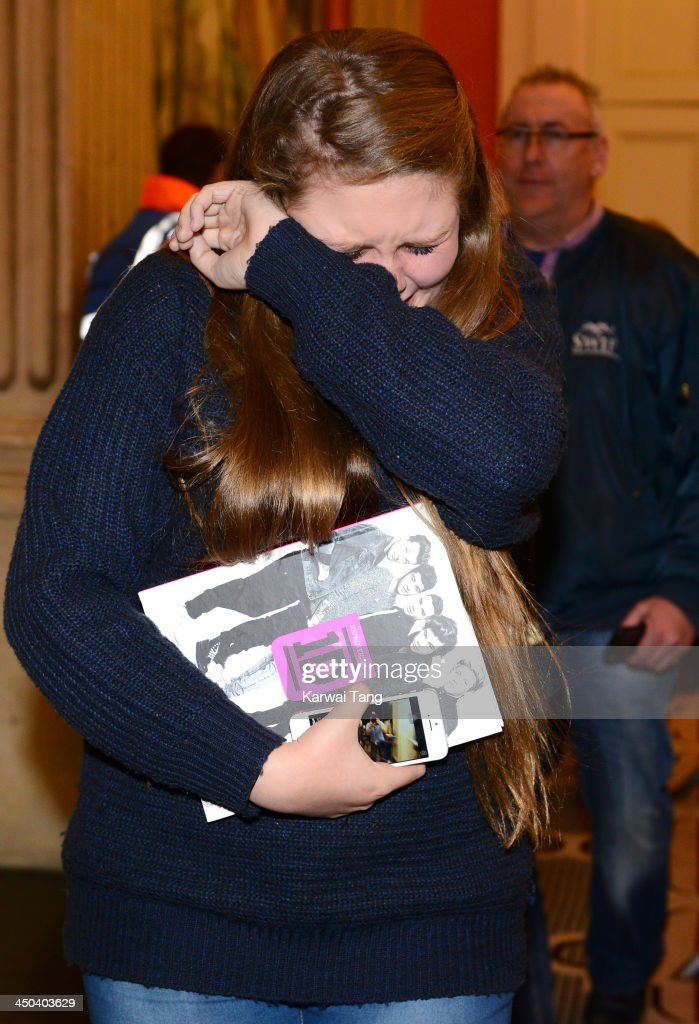 A fan attends the book signing of One Direction's new book 'Where We Are' held at Alexandra Palace on November 18, 2013 in London, England.