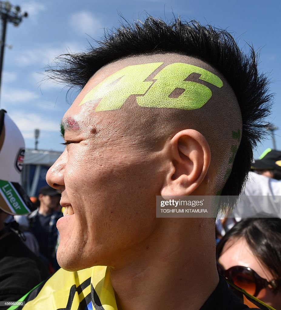 A fan awaits for Movistar Yamaha MotoGP rider Valentino Rossi of Italy at the paddock after the first free practice session of the MotoGP Japanese...