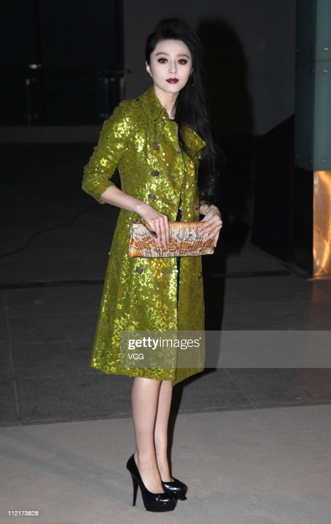 Fan Bingbing poses for photos as she arrives at the corporate event of the fashion apparel company Burberry at Sparkle Roll Plaza on April 13 2011 in...
