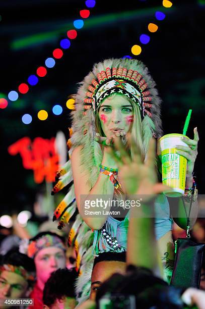 A fan blows a kiss at the 18th annual Electric Daisy Carnival at Las Vegas Motor Speedway on June 21 2014 in Las Vegas Nevada