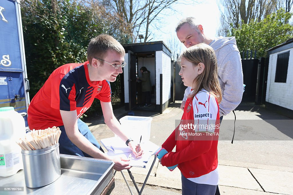 A fan buys draw tickets prior to the WSL match between Arsenal Ladies and Birmingham City Ladies at Meadow Park on May 1, 2016 in Borehamwood, England.
