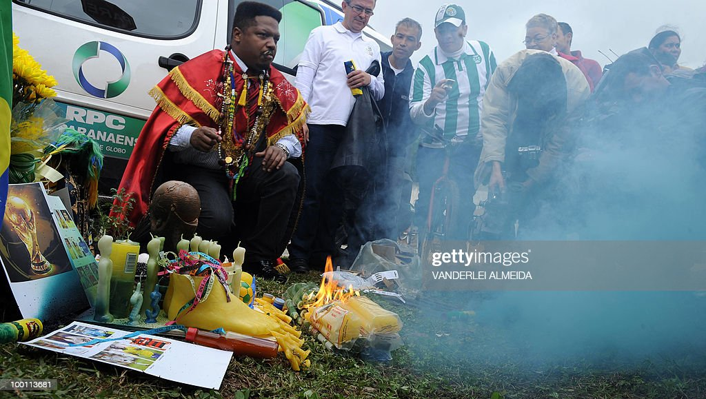 A fan carries out a 'Macumba' (African origin ritual) in front of the training center where the Brazilian football team gets prepared for the FIFA World Cup South Africa-2010, in Curitiva on May 21, 2010.
