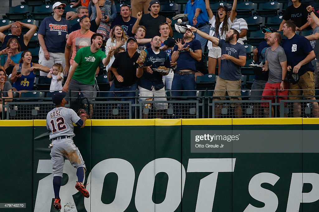 A fan catches a three-run home run off the bat of Logan Morrison of the Seattle Mariners as Center fielder <a gi-track='captionPersonalityLinkClicked' href=/galleries/search?phrase=Anthony+Gose&family=editorial&specificpeople=6906091 ng-click='$event.stopPropagation()'>Anthony Gose</a> #12 of the Detroit Tigers watches in the fifth inning at Safeco Field on July 6, 2015 in Seattle, Washington.