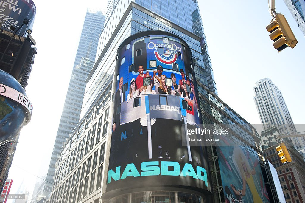Fan Cave Dwellers with Jacqueline Parkes Chief Marketing Officer of Major League Baseball appear on the NASDAQ tower after ringing the NASDAQ opening...