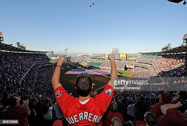A fan celebrates after the national anthem during Los Angeles Angels opening day ceremonies against the Oakland Athletics at the Angels Stadium of...