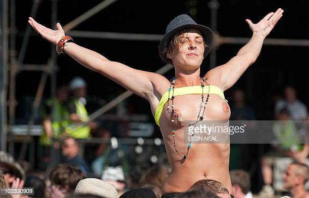A fan celebrates after watching England play Slovenia in the World Cup on the big screens of the Pyramid Stage at the Glastonbury festival near...