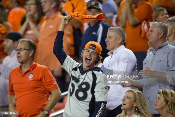 A fan celebrates during the Los Angeles Chargers vs Denver Broncos Monday Night Football game on September 11 at Sports Authority Field in Denver CO